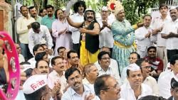 Physical education, art and music teachers protested against the education minister on Wednesday outside Academic Authority, Government of Maharashtra, regarding the decision to decrease the number of hours of the mentioned subjects in schools.