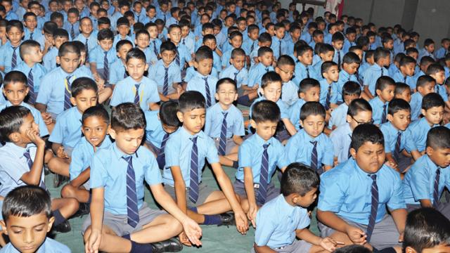 JN Petit school's Yoga team displayed their enthusiasm by recording a hundred per cent participation by doing Yoga aasanas in the school.