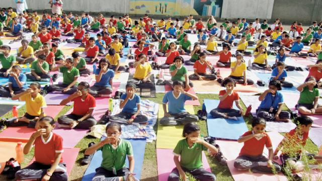 The students of Orbis School perform yogasanas on International Yoga Day.