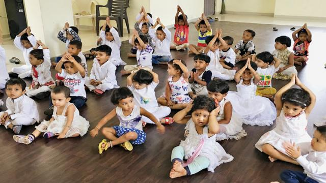 Students of Sunshine Pre-Primary School celebrate Int'l Yoga Day.