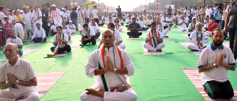 Uttar Pradesh Governor Ram Naik and Chief Minister Yogi Adityanath perform yoga during an event organised to mark the 5th International Day of Yoga, at Raj Bhawan in Lucknow,