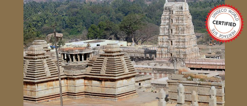 The grandiose site of Hampi comprises mainly the remnants of the capital city of Vijayanagara Empire (14th-16th Cent CE), the last great Hindu Kingdom. Located in Bellary district, Karnataka, Hampi's spectacular setting is dominated by river Tungabhadra,