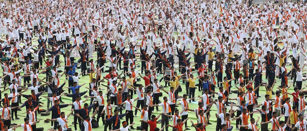 Yoga enthusiasts take part in a mass yoga session to mark the 5th International Day of Yoga, in Nagpur