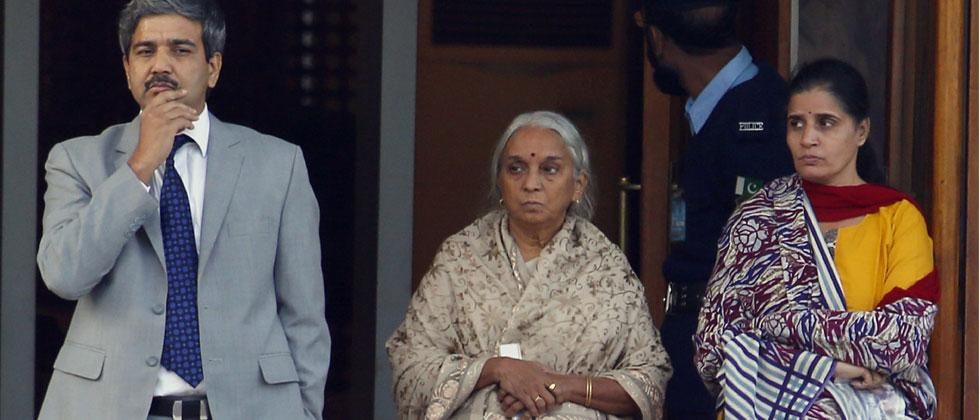 Imprisoned Indian naval officer Kulbhushan Jadhav's wife and mother are escorted by an Indian diplomat after meeting with Jadhav, who is facing death penalty in Pakistan for espionage and sabotage, at Foreign Ministry in Islamabad, Pakistan