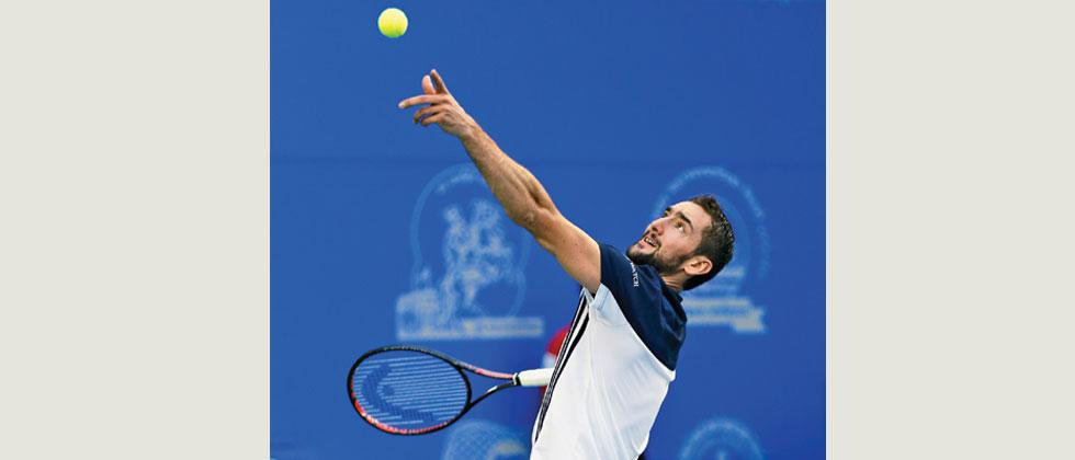 Marin Cilic prepares to serve against France's Pierre Hugues Herbert during their quarter-final match at the ATP 250 Series Tata Open Maharashtra