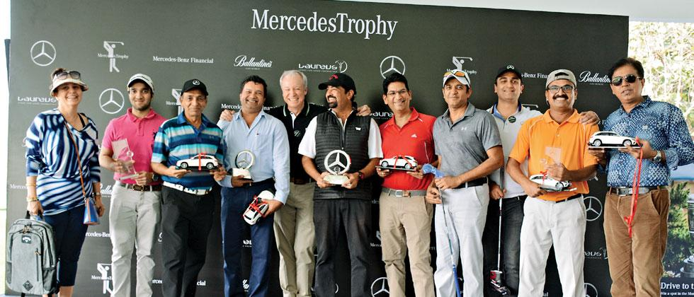Roland Folger, MD and CEO Mercedes Benz India Pvt. Ltd (centre) with all winners of the first Pune Qualifier of the 18th Mercedes Trophy Golf tournament at Oxford Golf Resort
