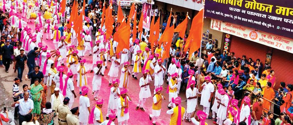 Dhol tasha group from Sangli performs in the procession