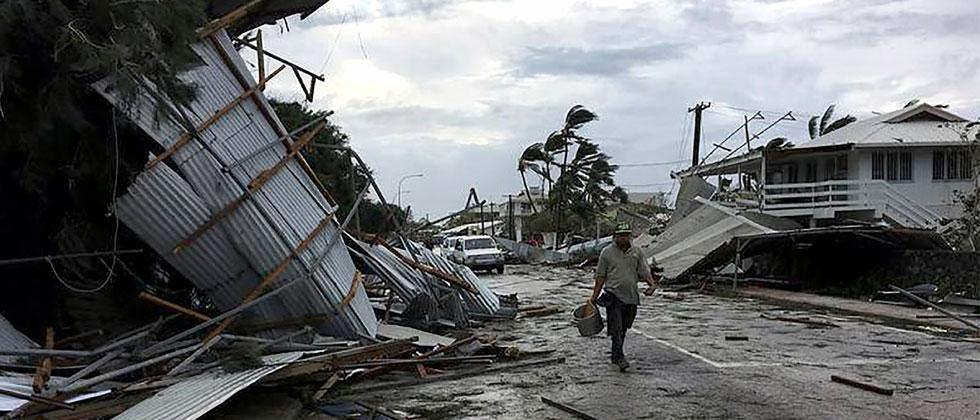 This handout photo taken and received from John Pulu from Tagata Pasifika on February 13, 2018 shows flooding and damage in Tonga's capital of Nuku'alofa after Cyclone Gita hit the country. Photo - John Pulu/AFP