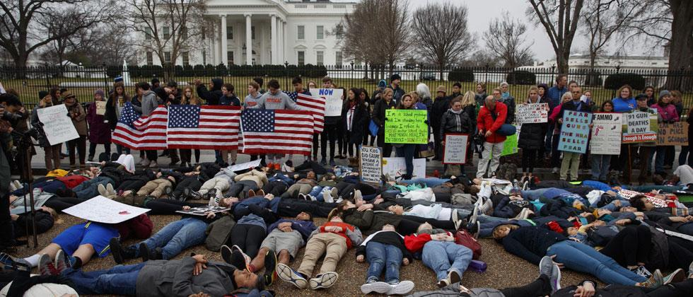"""Washington: Demonstrators participate in a """"lie-in"""" during a protest in favor of gun control reform in front of the White House, Monday, Feb. 19, 2018. Photo - AP/PTI"""