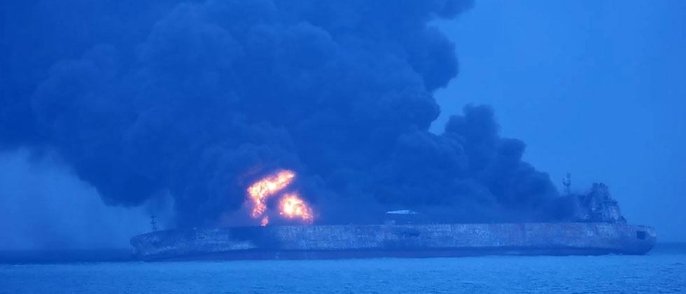 "This handout from the Korea Coast Guard taken and released on January 7, 2018 shows the Panamanian-flagged tanker ""Sanchi"" on fire after a collision with a cargo ship at sea. Thirty-two people, mostly Iranians, were missing on January 7 after an oil tanke"