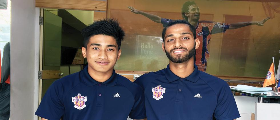 happy times: Mohammad Yasir (left) and Anuj Kumar in Pune.