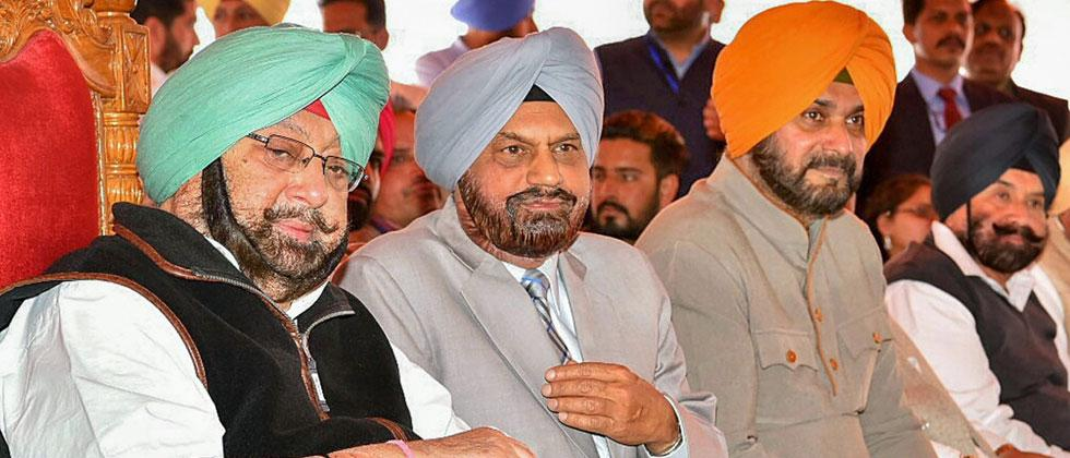 Punjab Chief Minister Capt Amarinder Singh, Punjab Congress President Sunil Jakhar, Punjab Tourism Minister Navjot Singh Sidhu during a rally organised to inaugurate the Jang-e-Azadi memorial in Jalandhar on Tuesday. Photo-PTI