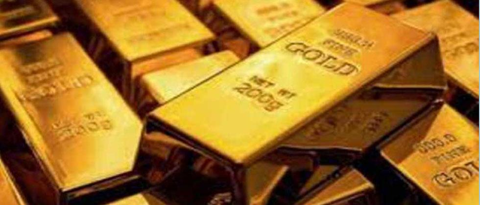 Gold falls marginally, silver rises Rs 52