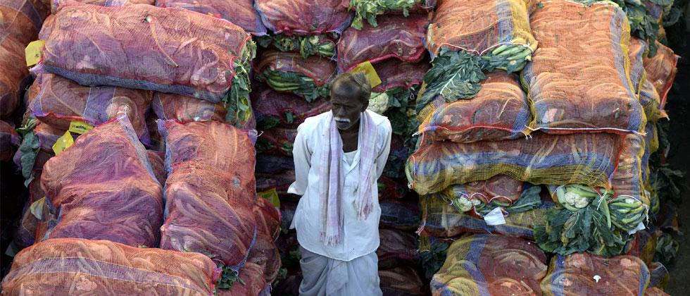 An Indian farmer with his produce waits to negotiate with traders at a wholesale vegetable market in Hyderabad on February 1, 2018. The Indian government is focusing on the agricultural sector in its annual budget, released on February 1. AFP Photo.