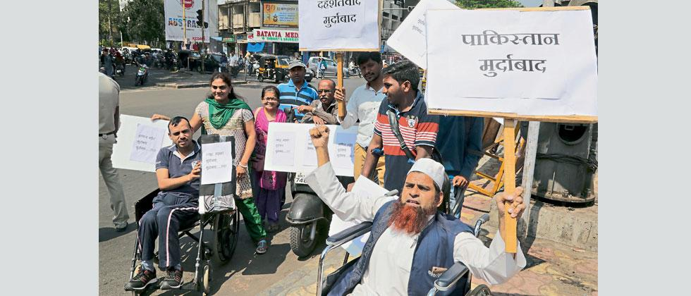 A group of physically challenged people condemn the terror attack on the Sunjwan army camp in Jammu, at Gokhale (Goodluck) Chowk in Deccan Gymkhana on Saturday.