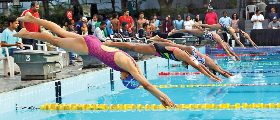 Action in Girls freestyle swmming competition at Sakal Schoolympics in Tilak Tank Deccan Gymkhana