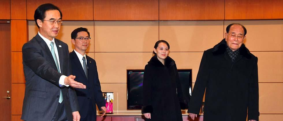 North Korea's ceremonial head of state Kim Yong Nam (R) and Kim Yo Jong (C), North Korean leader Kim Jong Un's younger sibling, are greeted by South Korea's Unification Minister Cho Myoung-gyon (L) upon their arrival at Incheon airport, west of Seoul, on
