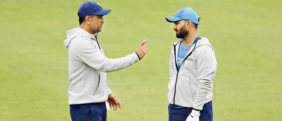 India's MS Dhoni (left) speaks to Rishabh Pant during a training session during the ongoing ICC Cricket World Cup in England. Pant has replaced Shikhar Dhawan in the squad.
