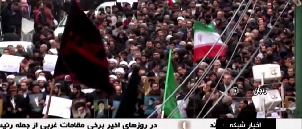 An image grab taken from a broadcast by Islamic Republic of Iran Broadcasting (IRIB) on January 1, 2018, shows Iranians chanting slogans as they march in support of the government in the northwestern city of Zanjan