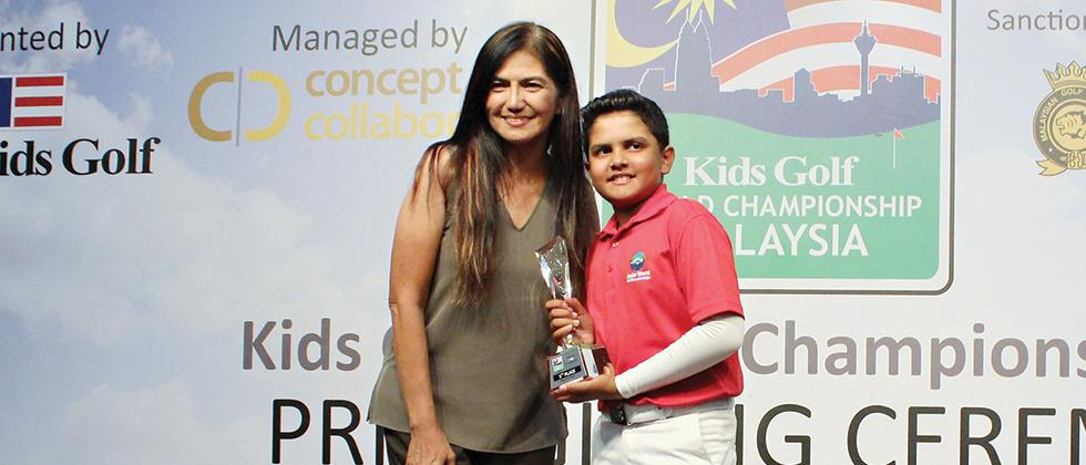 Aryaman Singh with the fifth place trophy at the Kids' World Championship held in Malaysia last week.