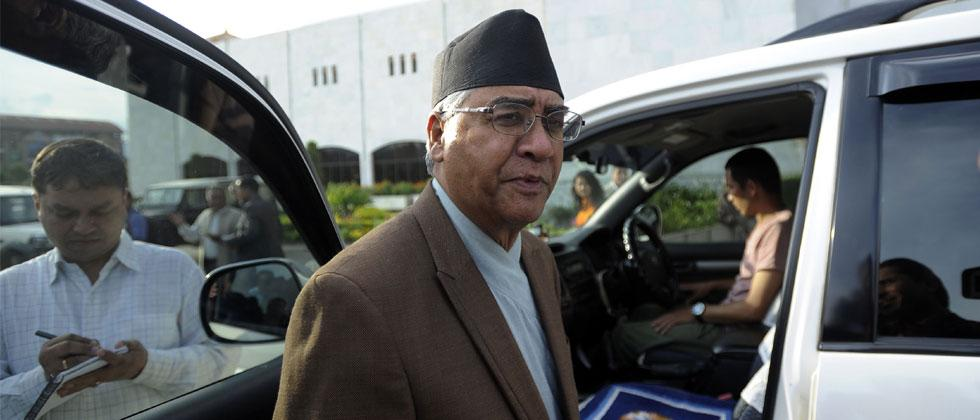File photo dated July 13, 2016 Nepali Congress President Sher Bahadur Deuba leaves the Parliament Building in Kathmandu. Nepal's Prime Minister resigned February 15, 2018, making way for a new Communist government to take power. Photo-AFP/Prakash Mathema