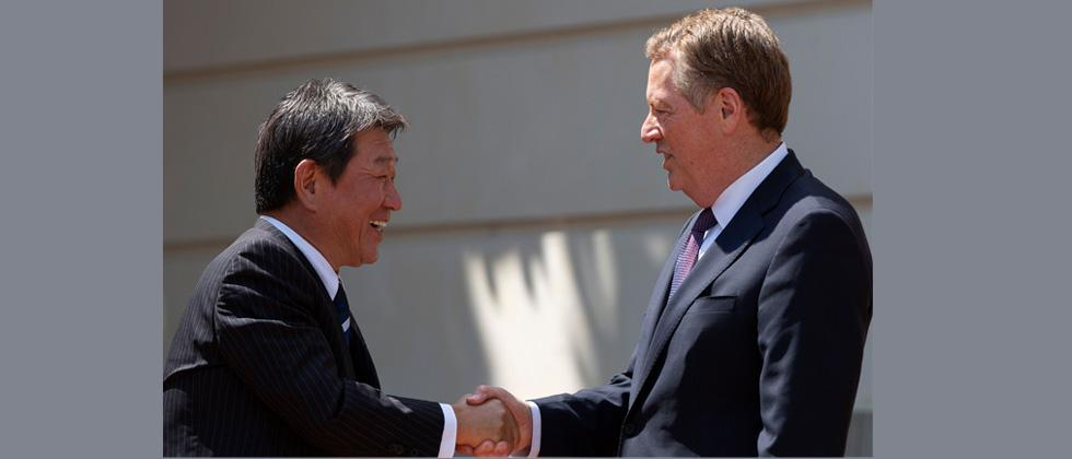 Japanese Minister of Economic Revitalization Toshimitsu Motegi(L) and US Trade Representative Robert Lighthizer shake hands prior to trade negotiations at the Office of the United States Trade Representative in Washington, DC.