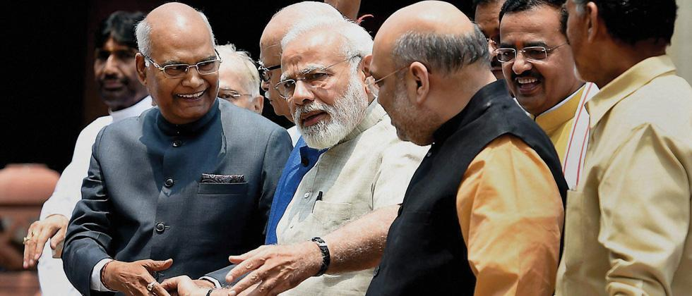 NDA's nominee for presidential election 2017 Ram Nath Kovind (L) arrives at the Parliament House complex, along with Prime Minister Narendra Modi, BJP chief Amit Shah and NDA leaders to file nomination papers on Friday.