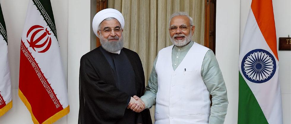 Iranian President Hassan Rouhani shakes hands with Indian Prime Minister Narendra Modi. Photo - Money Sharma/AFP
