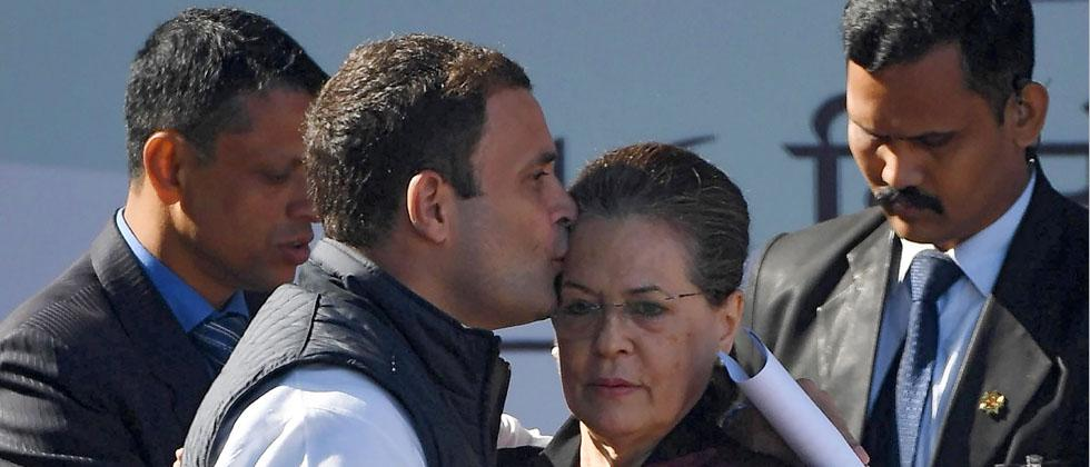 Newly elect Congress president Rahul Gandhi greets his mother and predecessor Sonia Gandhi after her speech during a grand elevation event held at the lawns of the All India Congress Committee (AICC) in New Delhi on Saturday. PTI Photo
