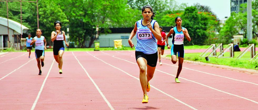 Nidhi Singh (bib no 0373) of Thane during the semi-final of the 400 metre race at Balewadi warm up ground on Friday.