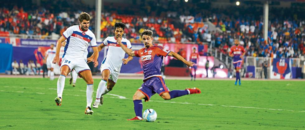 FC Pune City's Marcelinho in action against FC Goa during their ISL match on Sunday.
