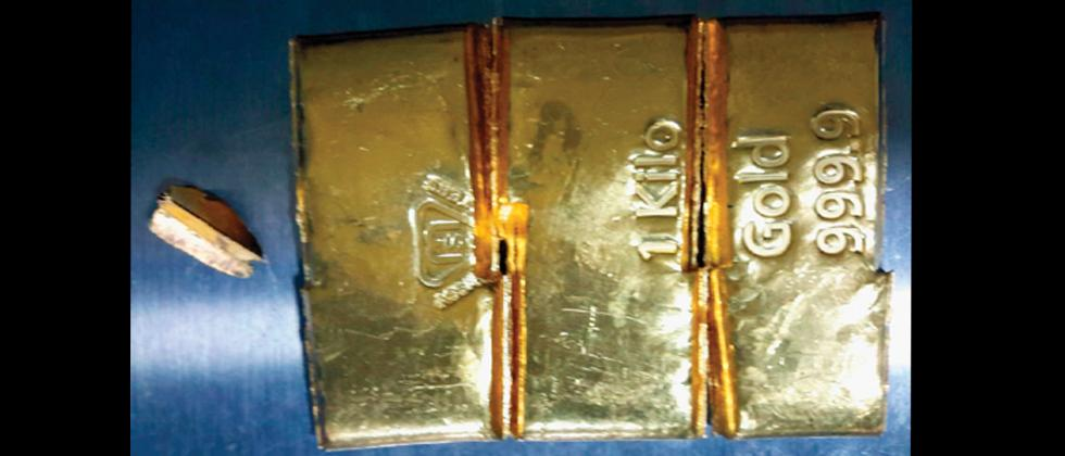 Woman carrying gold in sneakers nabbed