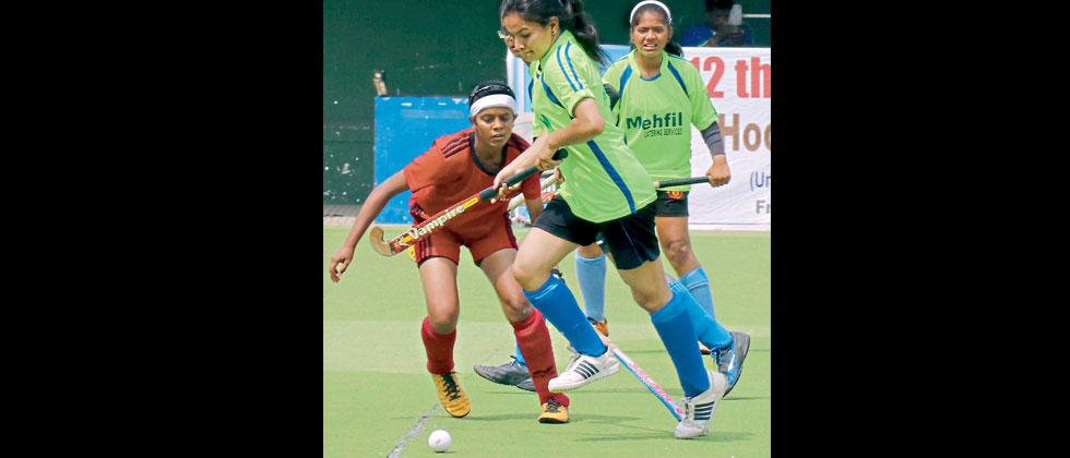 Players of 5 Star Sports Club (in red) in action against Priyadarshini Sports Centre on Friday