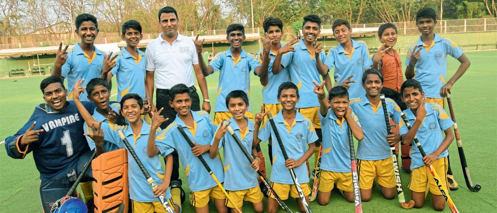 PCMC School team poses after winning the Father Schoch Memorial (Under-14) Inter-School Hockey tournament at Major Dhyan Chand Hockey Stadium