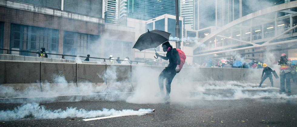Protesters react after police fired tear gas outside the government headquarters in Hong Kong on Saturday.