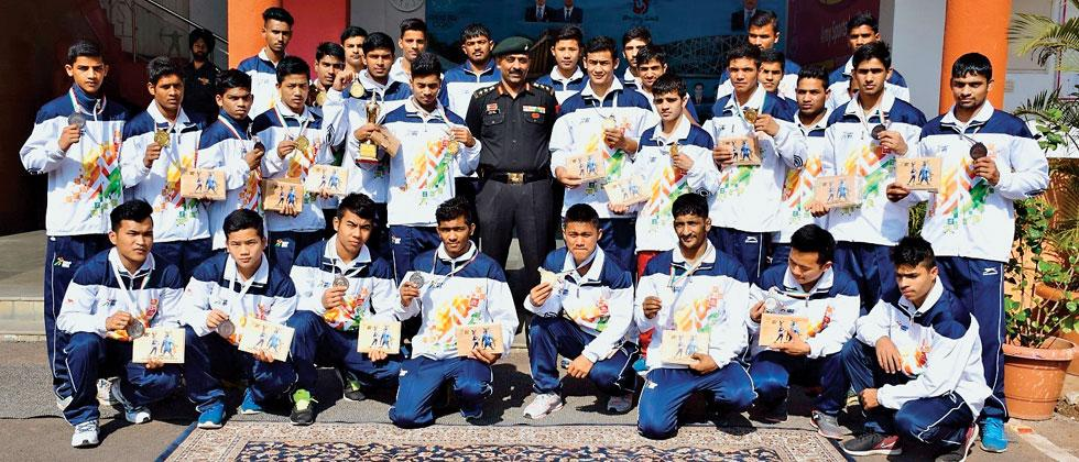 Sports cadets of Boys Sports Company School and Army Sports Institute, Pune pose with their medals after the prize distribution ceremony