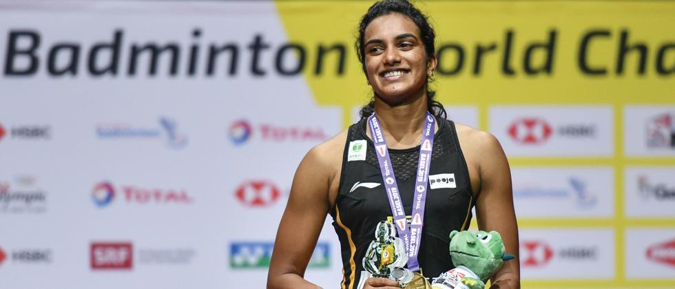 World champion Sindhu returns to hero's welcome, says feeling yet to sink in