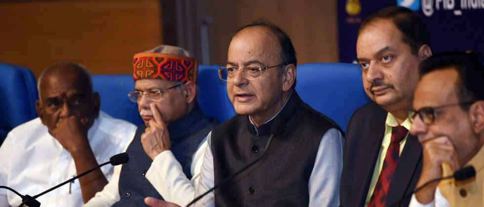 Union Finance Minister Arun Jaitley along with MoS, Shiv Pratap Shukla and MoS, Pon Radhakrishnan during a press conference after Union Budget 2018-19 presentation, in New Delhi on Thursday. PTI Photo by Subhav Shukla