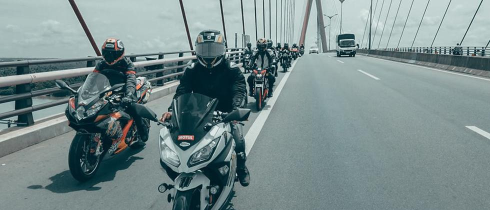 Check new guidelines for two-wheelers; mandatory for all motorbikes to have handholds