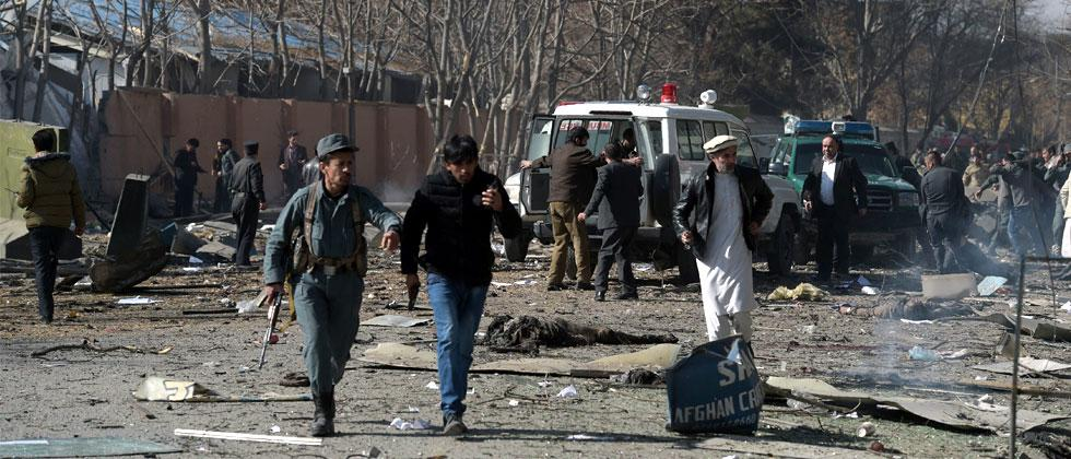Afghan volunteers and policemen carry injured men on an ambulance at the scene of a car bomb exploded in front of the old Ministry of Interior building in Kabul on January 27, 2018. Pic - AFP