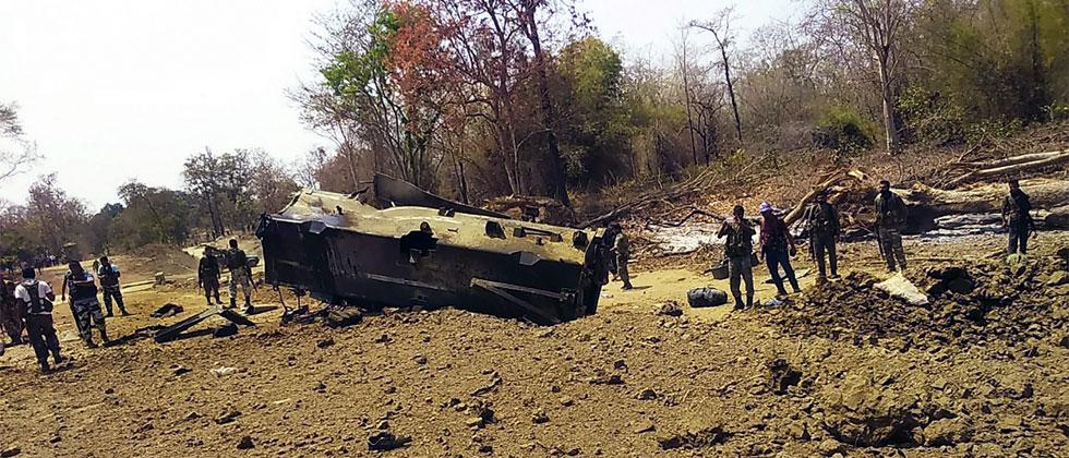 Security personnel inspect the site of an IED blast where nine CRPF personnel were killed and two more were injured after Maoists ambushed them in Kistaram area of Chhattisgarhs Sukma district on Tuesday. Photo/PTI