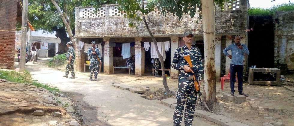 CRPF personnel guard at the house of the rape survivor at Maki village in Unnao district, Sunday, Aug 4, 2019
