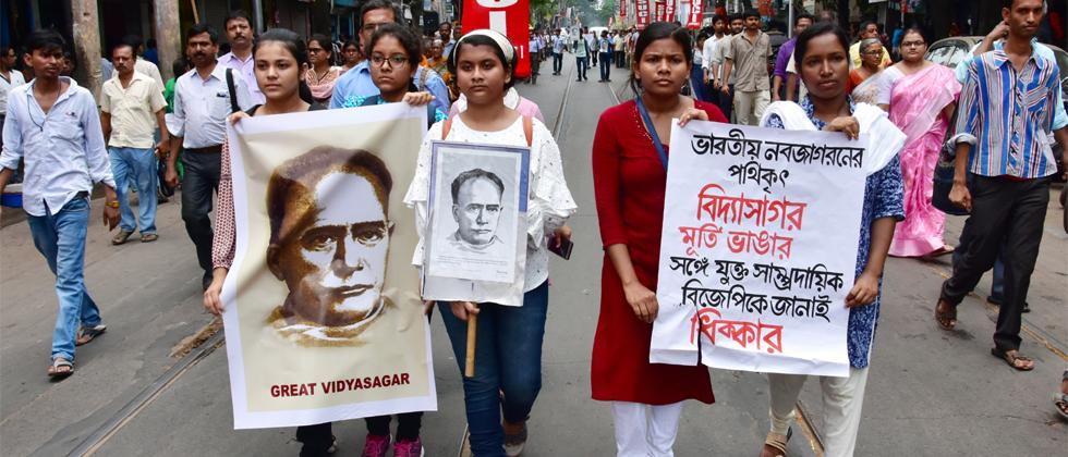 SUCI supporters hold Vidyasagar portrait during a protest rally against the broken of Vidyasagar statue in a college in Kolkata. This statue was broken in between the clashes of BJP and TMC party supporters during Amit Shah roadshow in Kolkata. ANI Photo