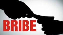 Civic official held for taking bribe