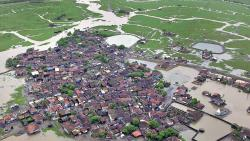 A file photo of inundated residential areas and agricultural land in Mumbai.