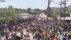 Migrant workers clash with police in Gujarat