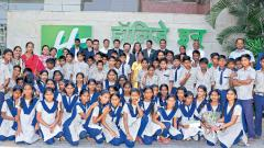 Holiday Inn Pune Hinjawadi staff members with students of Mhalunge Grampanchayat School