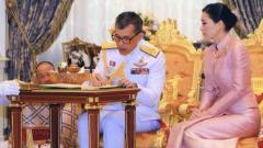 Thailand's King marries bodyguard, names her queen
