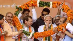 Prime Minister Narendra Modi being garlanded during an election campaign rally on the last day of the campaigning for the sixth phase of Lok Sabha polls, in Rohtak, on May 10, 2019. PTI Photo