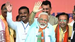 Prime Minister Narendra Modi wavs to his supporters during an election rally for the last phase of Lok Sabha polls in Khargone on May 17, 2019. ANI Photo